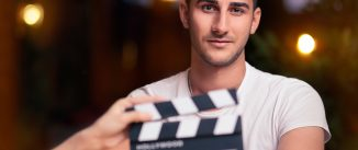 Portrait of a handsome man a ready to film a new scene