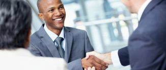 Angled view of a very happy African-American businessman shaking hands