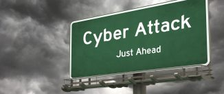 Green road sign saying Cyber Attack Just Ahead against grey cloudy background